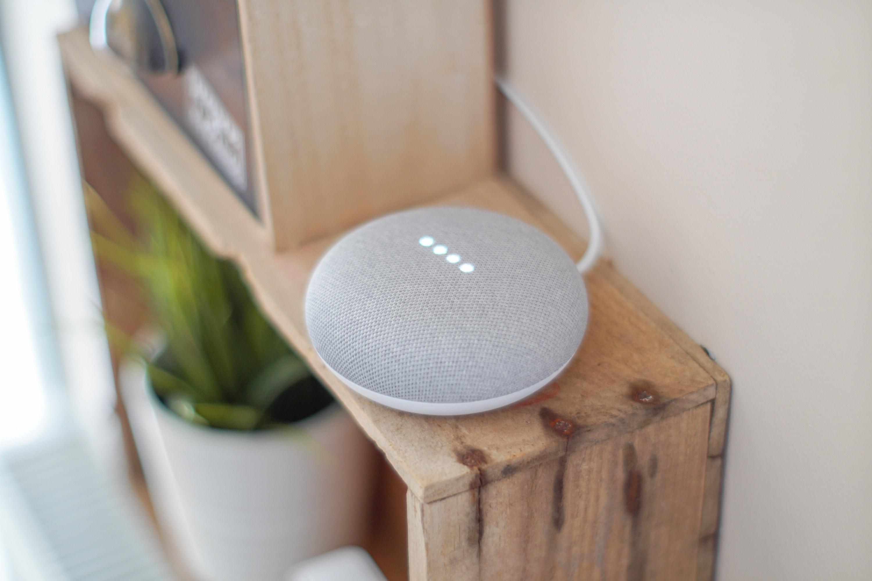 round-grey-speaker-on-brown-board-1072851